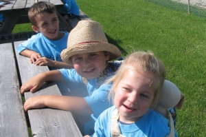 Happy children on a picnic table at Silver Tee